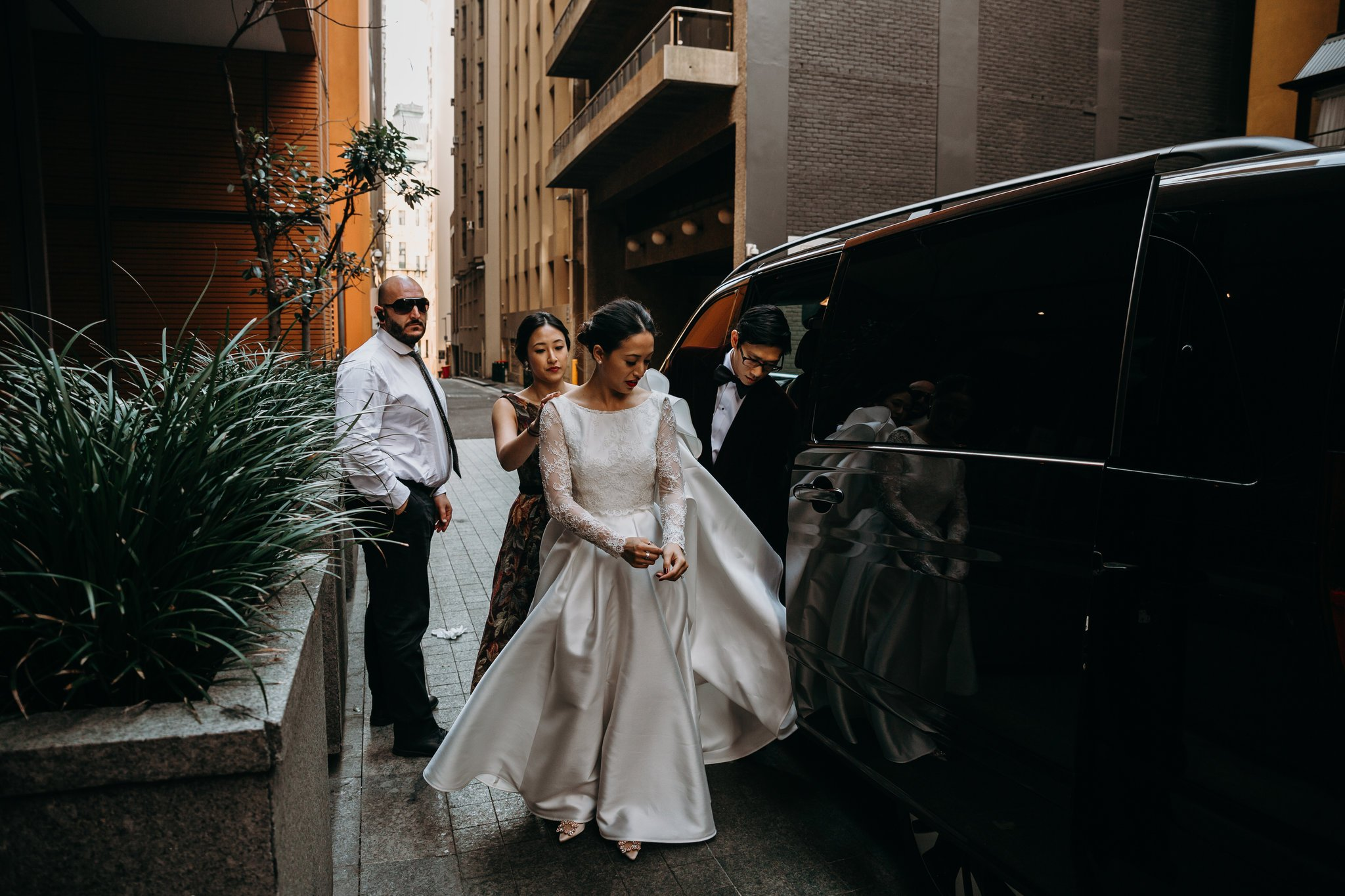 bride and groom arriving together